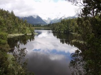 Lake Matheson - View to the cloudy Fox Glacier, Westland Glacier Country, South NZ