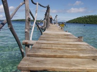 Bridge over smooth water - Popoa Island Resort, Vava'u Group