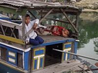 Children on fishing boat - Thu Bon River, Hoi An, Central Vietnam