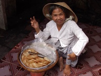 Rice Cakes on offer - Can Tho, Mekong Delta, South Vietnam
