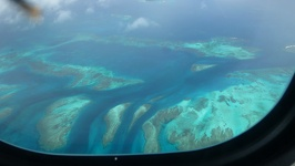 Coral reef and small islands - Pacific Ocean Air Caledonia aircraft