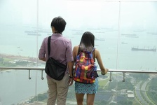 Couple looking down - Marina Bay Sands Hotel, Singapore